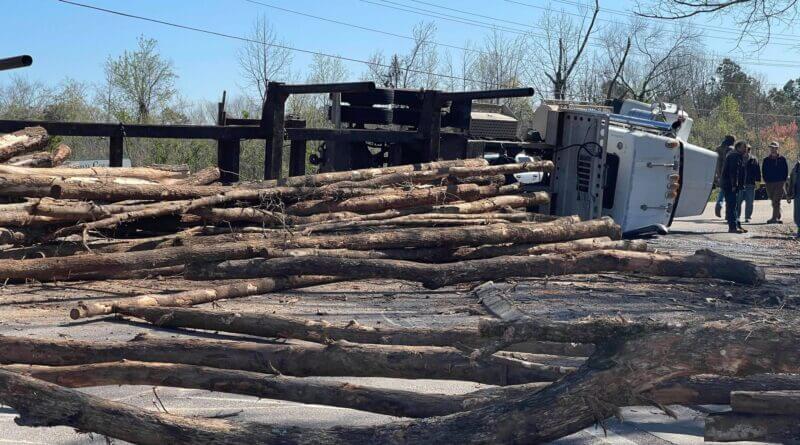 Log truck overturns at corner of Highway 15 and Industrial Park Thursday morning